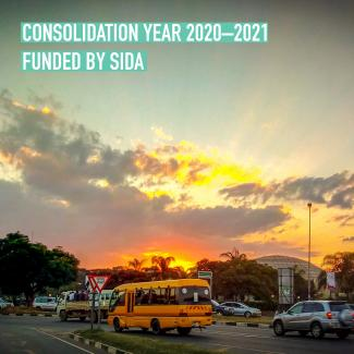 Cairo Rd in Lusaka. Text saying Consolidation Year Funded by Sida